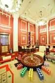 Bright and fashionable casino with tables — 图库照片