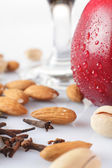 Nuts with red apple on white background — Stock Photo