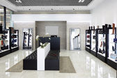 Interior of shoe store in modern european mall — Foto Stock