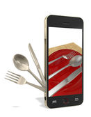 Phone and cutlery — Stock Photo