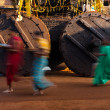 Stock Photo: Walking RathChariot Wheels Blurred