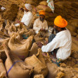 Sikh Men Packing Sacks Grain Charity Gurudwara - Stock Photo