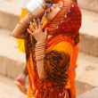 IndiHindu WomDrinking Ganges River Water — Stock Photo #22984448