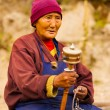 Tibetan Woman Pilgrim Praying Spinning Mani Wheel — Stock Photo