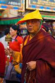 Tibetan Buddhist Monk Spinning Prayer Wheel — Stock Photo