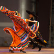 Stock Photo: Twisting MexicHat Dance Jalisco Orange Couple
