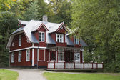 Red House in the Forest — Stock Photo