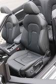 Convertible sportscar black leather seats — Stock Photo