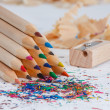 Triangular pile of colored wooden pencils — Stock Photo #19529871
