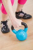 Hand grabbing fitness equipment — Stock Photo