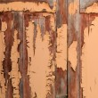 Old door with textured paint falling apart — Stock Photo