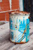 Old and rusted paint tin — Stock Photo