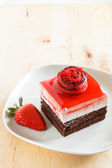 Strawberry bavaroise with chocolate cake — Stock Photo