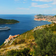 Scenic view of Dubrovnik coast with cruze ship - Stock Photo