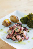Octopus in Olive Oil with roasted potatoes and broccoli — Stock Photo