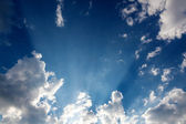 Sun rays through clouds — Stock Photo