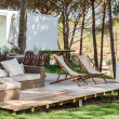 Summer house deck with chairs and sofa — Stock Photo #41490941