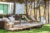 Summer house deck with chairs and sofa — Stock Photo