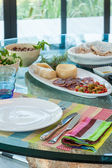 Table setting in summer holiday house — Stock Photo
