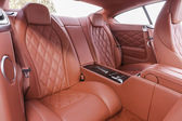 Red back passenger seats in modern luxury comfortable car — Photo
