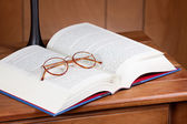 Glasses, book on table — Stock Photo