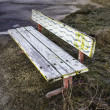 Bench old and lively painted — Stock Photo