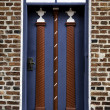 Old skewed door in Ribe, Denmark - Stock Photo