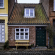The smallest house in Ribe, Denmark - Stock Photo