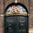Old door in Nyhavn in Copenhagen harbor, Denmark — Stock Photo #45961113