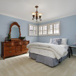 Master bedroom with blue walls — Stock Photo