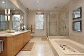 Master bath with oak wood cabinetry — ストック写真