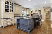 Upscale kitchen with granite island — Stok fotoğraf