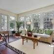 Sunroom with red brick flooring — Stock Photo