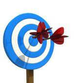 Darts arrows flying in center of target — Stock Photo
