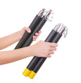 Two ninja nunchucks in hands isolated on white — Stock Photo
