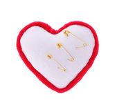 Safety pins pierce plush heart isolated on white, broken heart concept, needle bar — Stock Photo