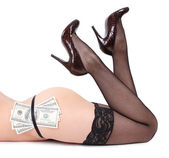 Sexy legs and money isolated on white background — Stock Photo