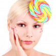 Young girl with fashion makeup and lollipop isolated on white - Stock Photo