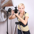 Professional photographer, young beautiful girl with the camera in photo studio — ストック写真 #13973639