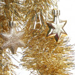 Gold Christmas toy stars and sparkling tinsel — Stock Photo