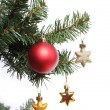 Red ball and gold stars on Christmas tree branch, isolated on white background, Christmas decoration — Stock Photo