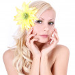 Very beautiful girl with yellow flower in her blonde hair isolated on white, spa — Stock Photo