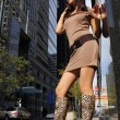 Young girl in sexy boots posing in a city — Stock Photo