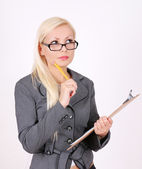 Portrait of thinking business woman in glasses with pen and clipboard isolated on white — Stock Photo