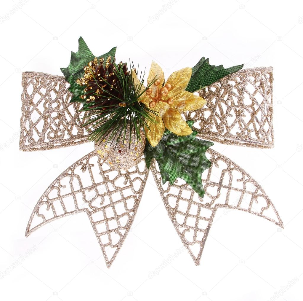 Christmas glitter bow decorated with pine cone, gold apple and holly berry leaves isolated on white background — Stock Photo #16161463