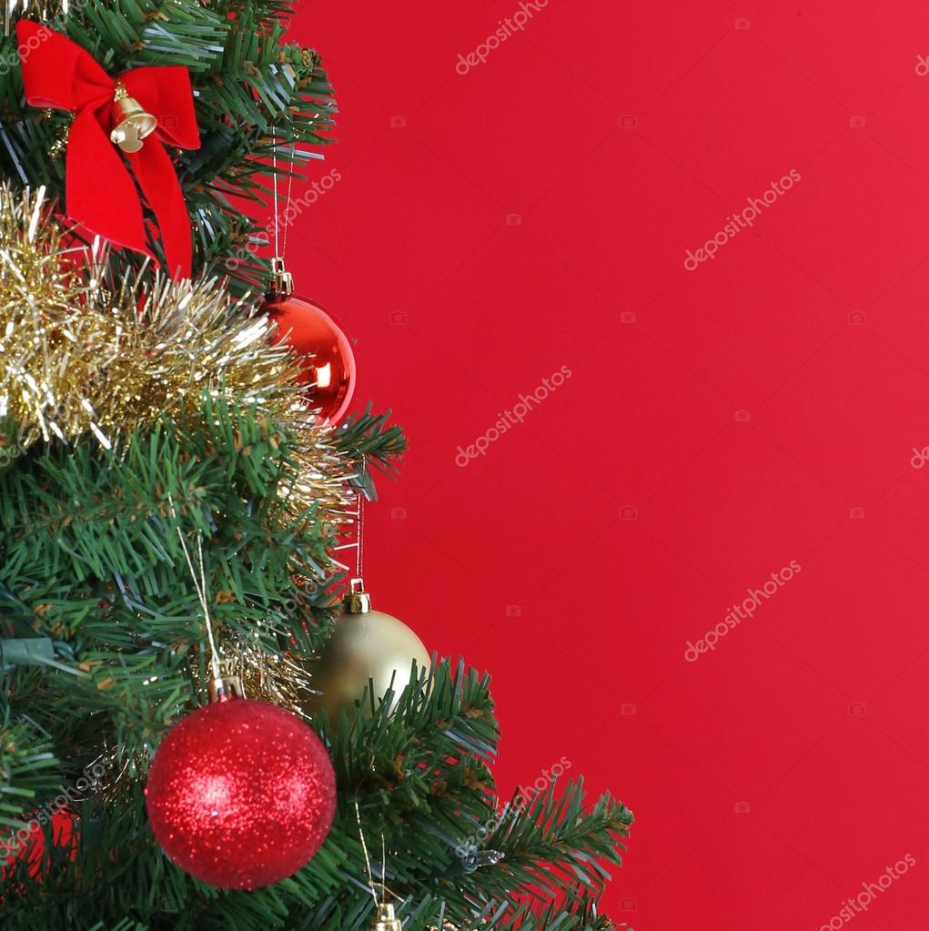 Christmas balls on Christmas tree branch, over red background — Stock Photo #16848017