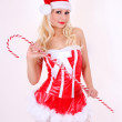 Blonde Santa girl with huge candy cane stick on white background — Stock Photo