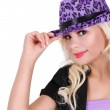 Blonde young woman wearing purple leopard print hat, isolated on white, party girl — Stock Photo #18517943