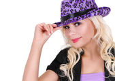 Blonde young woman wearing purple leopard print hat, isolated on white, party girl — Stock Photo