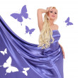 Sexy blonde young woman in blue silk dress with butterflies isolated — Stock Photo